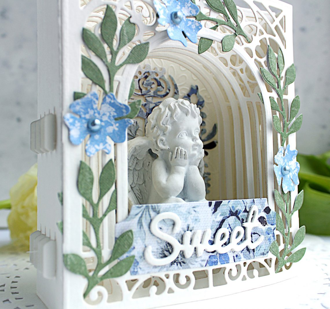 Video Friday | Paper Diorama / Figurine Holder with Olga using S3-303 Little Plants, S4-563 Phrase Set One, S4-883 Nordic Tree, S5-338 Wreath Elements, S6-138 Grand Arch 3D Card, SES-013 Flourish Stitch #spellbinders #diecutting