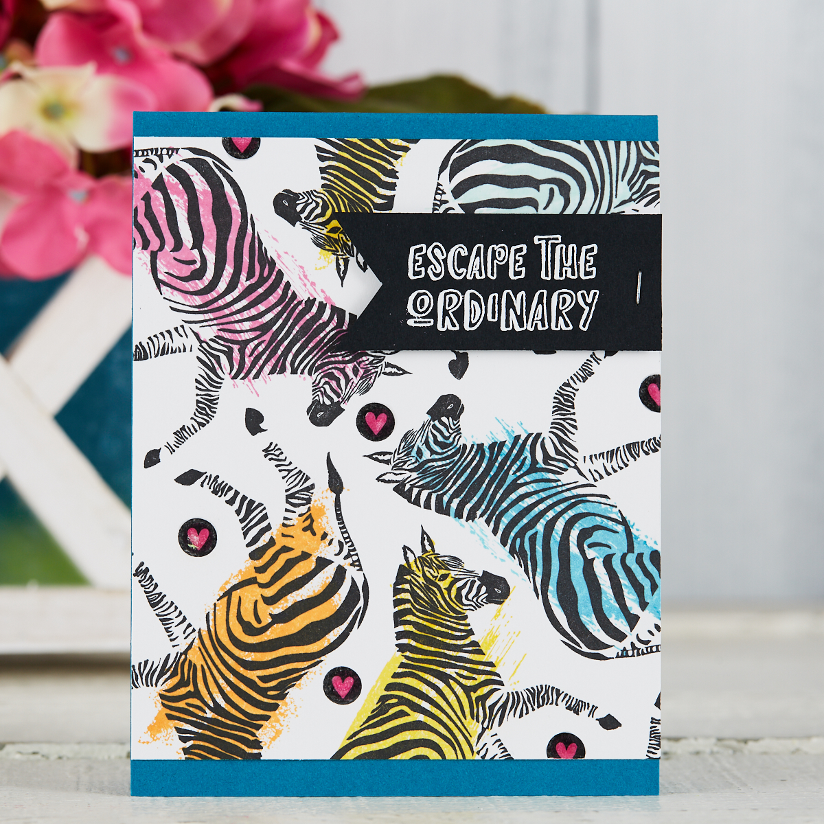 Escape the Ordinary card with rubber stamped zebras in bright colors created by Laura Williams with Fun Stampers Journey #funstampersjourney #cardmaking