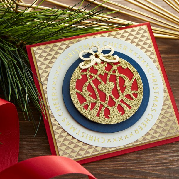 "GLP-180 Christmas Essential Glimmer Circles: The set of 3 glimmer plates can layer together, be used by themselves as a framed element for a card or in conjunction with the Essential Circles set (S4-1039). The ""X""s are not only sending ""kisses"" but have that cross stitch effect that is perfect for any Christmas card. What's New 